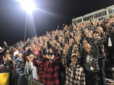 Student Football Fans Stop Rival's Insults with Simple Gesture